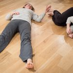 An image of 2 people moving on the floor exploring contact