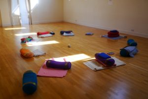 a circle of cushions in a movement studio